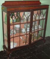 Serpentined front large display cabinet